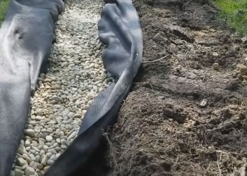 west bloomfield mi french drain install trencher vs excavator