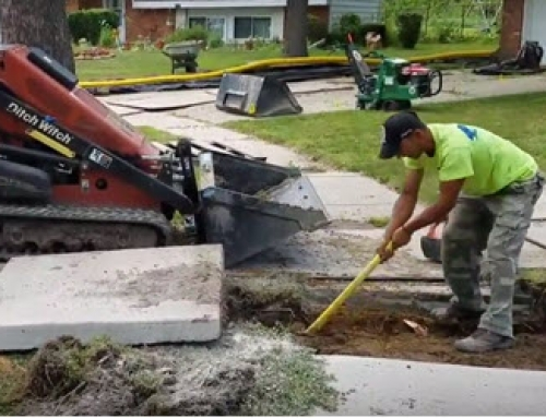 Section of sidewalk removed to install a French Drain in Oakland County